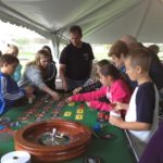 Fun at the Roulette table at outdoor company picnic