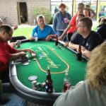 Texas Holdem Poker table at Wegman outdoor company event